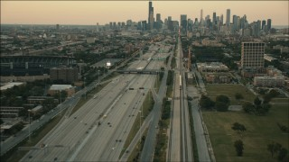 PP001_023 - HD stock footage aerial video of a commuter train heading toward Downtown Chicago at sunset, Illinois