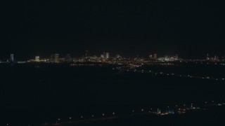 PP003_001 - HD stock footage aerial video of approach hotels and casinos of the skyline of Atlantic City, New Jersey at night