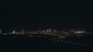 PP003_003 - HD stock footage aerial video approach the city skyline with hotels and casinos in Atlantic City, New Jersey at night