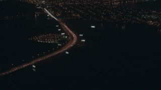 PP003_007 - HD stock footage aerial video of heavy traffic on a city street at night, Atlantic City, New Jersey