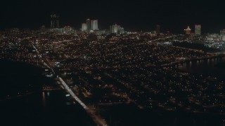 PP003_008 - HD stock footage aerial video tilt from busy street to reveal hotels and casinos at night, Atlantic City, New Jersey