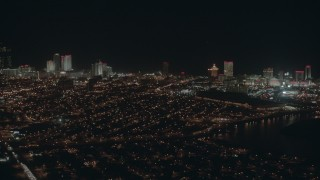 PP003_009 - HD stock footage aerial video of panning across hotels and casinos at night in Atlantic City, New Jersey