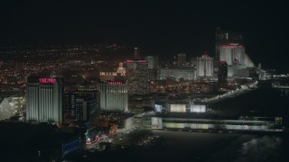 PP003_020 - HD stock footage aerial video of several beachside hotels and casinos at night in Atlantic City, New Jersey