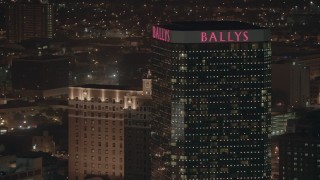 PP003_021 - HD stock footage aerial video of flying by the top of a hotel and casino at night, Atlantic City, New Jersey