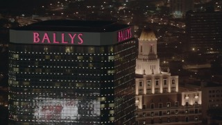 PP003_022 - HD stock footage aerial video of passing the top of a hotel and casino at night in Atlantic City, New Jersey