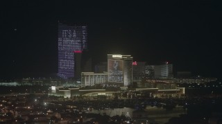PP003_023 - HD stock footage aerial video of flying by casinos and hotels at night in Atlantic City, New Jersey