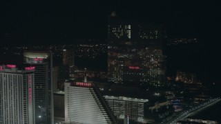 PP003_024 - HD stock footage aerial video flyby three hotels and casinos at night in Atlantic City, New Jersey