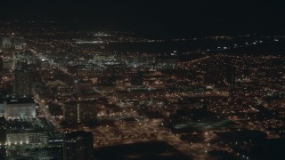 PP003_026 - HD stock footage aerial video of flying by city apartment buildings at night in Atlantic City, New Jersey