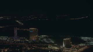 PP003_027 - HD stock footage aerial video pan across hotels, casinos, and city sprawl at night in Atlantic City, New Jersey