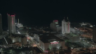 PP003_029 - HD stock footage aerial video approach Trump Taj Mahal Hotel and Casino at night in Atlantic City, New Jersey