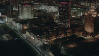 PP003_031 - HD stock footage aerial video of tilting from hotels and casinos to the park and boardwalk at night in Atlantic City, New Jersey