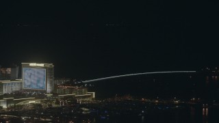 PP003_034 - HD stock footage aerial video of panning from Golden Nugget hotel and casino to a bridge at night, Atlantic City, New Jersey