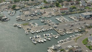 PP003_040 - HD stock footage aerial video fly over riverfront homes and a marina in Seaford, New York