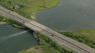 PP003_041 - HD stock footage aerial video of a fishing boat sailing under a bridge in Seaford, New York