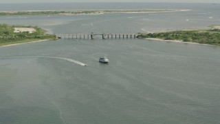 PP003_047 - HD stock footage aerial video of approaching a ferry and a bridge in Point Lookout, New York