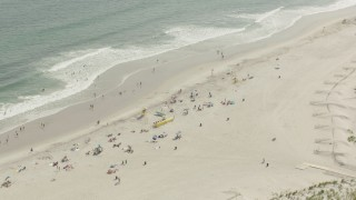 PP003_051 - HD stock footage aerial video of approaching sunbathers on the beach, Lido Beach, New York