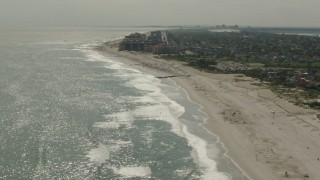 PP003_052 - HD stock footage aerial video of tilting from sunbathers on the beach to the Lido Beach coastal community in New York