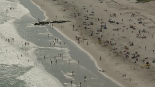 PP003_053 - HD stock footage aerial video of approaching sunbathers on the beach, Long Beach, New York
