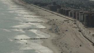 PP003_055 - HD stock footage aerial video of beach-goers near the boardwalk in Long Beach, New York