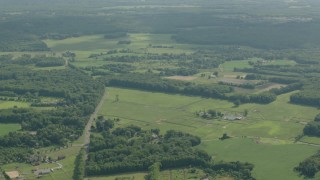 PP003_058 - HD stock footage aerial video of a rural landscape of farms and fields in Jackson, New Jersey
