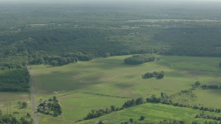 PP003_060 - HD stock footage aerial video of a rural landscape of farm fields in Jackson, New Jersey