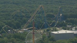 PP003_071 - HD stock footage aerial video orbit ride to reveal roller coaster at Six Flags Great Adventure theme park in Jackson, New Jersey