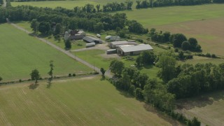PP003_076 - HD stock footage aerial video of fly over fields to approach barns at a farm in Jackson, New Jersey