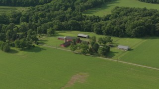 PP003_079 - HD stock footage aerial video flyby barns and green fields at a farm in Jackson, New Jersey