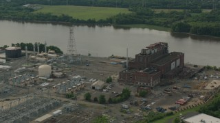 PP003_082 - HD stock footage aerial video of passing a riverfront power plant in Burlington, New Jersey