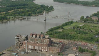 PP003_083 - HD stock footage aerial video orbit power plant to reveal a bridge spanning the river in Burlington, New Jersey