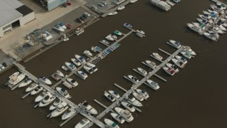 PP003_086 - HD stock footage aerial video of a bird's eye view of boats at a small river marina in Delran, New Jersey