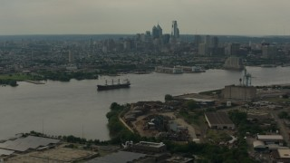 PP003_087 - HD stock footage aerial video skyscrapers of the city skyline seen from across the river, Downtown Philadelphia, Pennsylvania