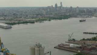 PP003_088 - HD stock footage aerial video of the city's skyscrapers and skyline seen from the river, Downtown Philadelphia, Pennsylvania
