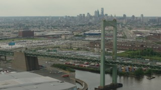 PP003_090 - HD stock footage aerial video of a view of Downtown Philadelphia skyline, seen while passing piers and Walt Whitman Bridge, Pennsylvania