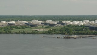 PP003_094 - HD stock footage aerial video of flying by riverfront oil refinery and tanker in Westville, New Jersey