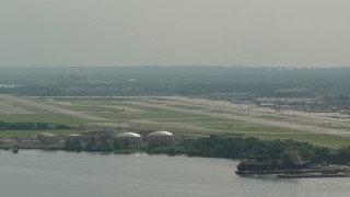PP003_095 - HD stock footage aerial video of the Philadelphia International Airport in Pennsylvania, seen from the river