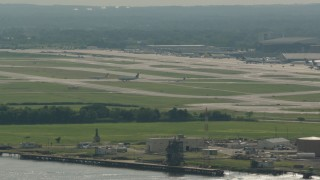 PP003_096 - HD stock footage aerial video of commercial planes at Philadelphia International Airport, Pennsylvania