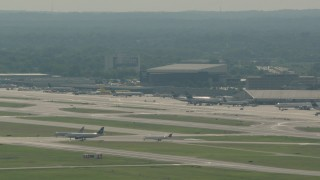PP003_097 - HD stock footage aerial video of commercial planes on the runways at Philadelphia International Airport, Pennsylvania