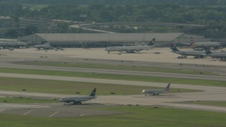 PP003_098 - HD stock footage aerial video of a commercial jet taxiing on the runway at Philadelphia International Airport, Pennsylvania
