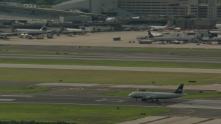PP003_099 - HD stock footage aerial video of a commercial airplane on the runway at Philadelphia International Airport, Pennsylvania