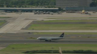 PP003_100 - HD stock footage aerial video track a commercial airplane taking off from Philadelphia International Airport, Pennsylvania