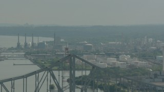 PP003_102 - HD stock footage aerial video ascend over the Commodore Barry Bridge to reveal an oil refinery in Chester, Pennsylvania
