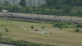 PP003_106 - HD stock footage aerial video of a commuter train running by the river in Wilmington, Delaware