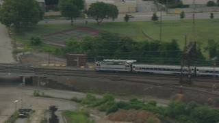 PP003_111 - HD stock footage aerial video of tracking a commuter train cruising through Wilmington, Delaware