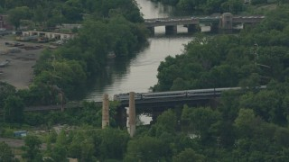 PP003_112 - HD stock footage aerial video of tracking a commuter train crossing a river in Wilmington, Delaware