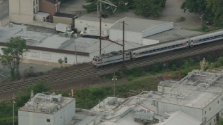 PP003_113 - HD stock footage aerial video tracking a passenger train cruising through Wilmington, Delaware