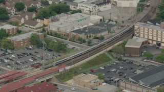 PP003_115 - HD stock footage aerial video of a commuter train arriving at a station in Wilmington, Delaware