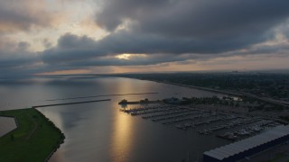 PVED01_001 - 4K stock footage aerial video of Lake Pontchartrain and a marina at sunrise, New Orleans, Louisiana