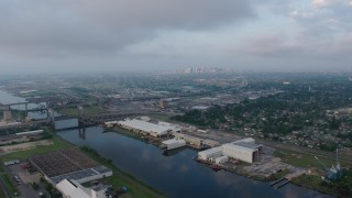 PVED01_002 - 4K stock footage aerial video of Industrial Canal in Upper Ninth Ward at sunrise, New Orleans, Louisiana