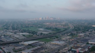 PVED01_003 - 4K stock footage aerial video of Downtown New Orleans skyline from Gentilly at sunrise, Louisiana